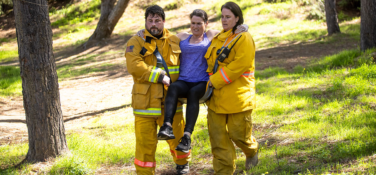 rescuers carry injured person in sling